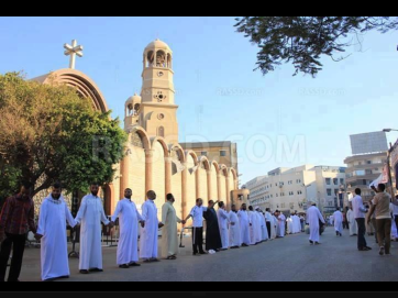 Muslims protecting a church while Christians worship in Egypt.